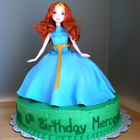 Merida From Brave Base cake is marble with chocolate filling and the dress is vanilla with cherry filling. Dress and body decorated in fondant.