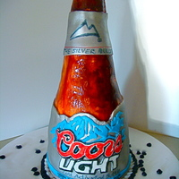 Coors Light Bottle This cake turned out OK. I wish I could have spent more time on it but I just didn't have time on my side with this one. The coloring...