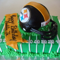 Steelers Helmet Cake  I made this for a Steelers Fans birthday. My second helmet cake. The face mask went a lot smoother with this helmet cake than my last one....