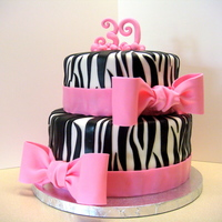 39Th Birthday Zebra Print Cake  I have wanted to try zebra print for awhile now and this was my first go at it! I think it turned out really well. Making the bows was my...
