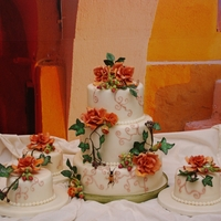Wedding Cake With Gumpaste Autumn Flowers   3 tier weddingcake and 3 small give-away cakes with gumpaste flowers
