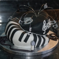 Music Themed Mad Hatter 40Th 40th b day cake for a friend who is a musician as well. cutters used for the trbble clef and quavers wired and inserted as topper.