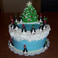 Penguins On Parade  Whipped cream frosting & snow, cream cheese borders and leaves, modeling candy penguins, red hot ornaments, candy star. The evergreen...