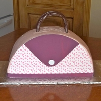Purse Cake I got this idea from Wilton. The cake is frosted with raspberry laced whipped cream. The heart decorations and purple trim are made from...