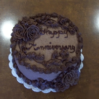 Chocoholic's Delight  Twenty-nine roses made from modeling chocolate adorn this anniversary cake celebrating the same number of years. It's frosted with...