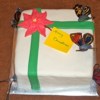 Butterfly Gift Cake  Everything on this cake is completely edible. I made the butterflies from a tutorial I found right here on Cake Central. The gift tag...
