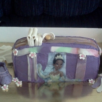 Princess & The Frog Diaper Bag   flowers, pacifier, baby booties, baby bottle, keys, diapers, and wipes are all edible