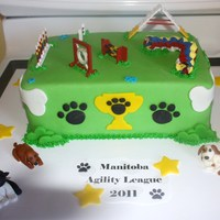 Dog Agility Cake Vanilla Cake with vanilla BC, dogs made out of fondant, agility equipment made out of wood