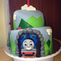 Thomas Topsy Turvy   Thomas on one side coming out of the cake, and Percy on the other side.