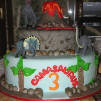 Camasaurus! Dino Cake Everything is edible except the dinosaurs. Hand painted rocks, all details done in MMF. It was a birthday present to my best friends son...