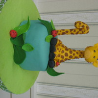 First Birthday Smash Cake Chocolate pudding cake, with buttercream frosting and filling, covered in MMF. The giraffe is hand made in MMF. Everything edible. Made to...
