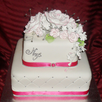 Pink Roses Fairytale Wedding   Square mudcake iced and decorated with icing flowers and diamontes for details