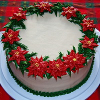 Christmas Wreath Cake I made this cake as a my contribution to the dessert table at my husband's family potluck for Christmas Day. All decoration is piped...