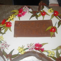 'australia'  This was a cake I made to welcome home someone who has been traveling for about 6mths. Fruit cake covered in fondant with gumpaste...