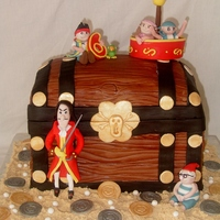 Jake & The Neverlands Pirates 6 layer choc & caramel cakes covered in fondant with fondant decorations and characters. Thanks to someone on cc suggesting to paint...