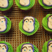 Buzz Lightyear Cupcakes Sculpted fondant Buzz head on Gluten- , Diary-, and Soy-free cupcakes.