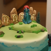 Princess Merida From Brave  My friend wanted a small but fun cake based on Brave for her granddaughter. I sculpted the large stones and piped the letters out of sugar...