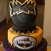 Dino Thunder Power Rangers Rice Crispy Treat mask on a two tiered cake. My friend made the cake for her grandson's birthday and I decorated it for her.