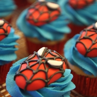 Spiderman Cupcakes Sculpted Spiderman head on gluten-, diary-, and soy-free cupcakes.