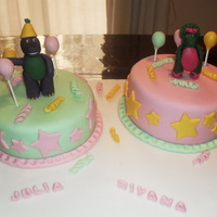 Barney And Baby Bop Cake barney is a chocolae covered wih vanilla BTC and the oher cake is vanilla cake with chocolate frosting