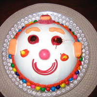 Clown Face all candy decorations. the choc syrup i used for eyes spread out a little.
