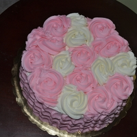 Rose Cake   used two of the techniques that I like. petal effect and rosettes.
