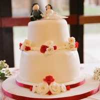 Close Up Of Red And Ivory Wedding Cake