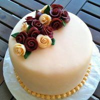 Burgundy And Beige Rose Cake Chocolate cake and cream with raspberry jam filling.TFL.