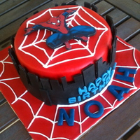 Spiderman Cake WASC cake, whipped cream and cherry filling. Everything made of fondant. The photo is rice paper on fondant.