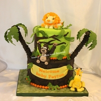 "Funfari Jungle Baby Shower Cake FunFari Jungle Themed Cake-8"" Marble cake filled and covered in vanilla bc, covered in white chocolate ganache and Fondx Elite fondant..."