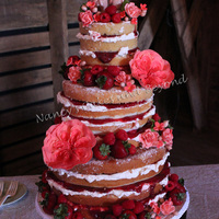Naked Cake With Sugar Cabbage Rose My first naked cake! Bride wanted fruit filling with some buttercream and fresh fruit. Topper was given to me by the bride.