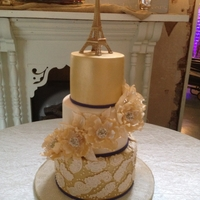 Gold Paris Themed Wedding Cake The original design was by Sharon Wee Creations who does amazing work! Even the flower was done using her flower tutorial! The gold is all...