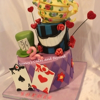 Alice In Wonderland Tea Party Cake The design of this cake came from Yuma Couture Cakes and with permission I did pretty much the same thing except changed up the tea pot to...