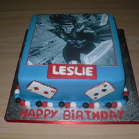 Gambit/marvel Cake This cake was made for my bf which likes marvel and one of his favourite caracters is Gambit. The picture is made on an icing sheet as I...