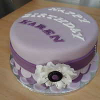 Lilac/purple Birthday Cake I got my inspiration from other users on this website. It is a madeira cake with coconut and chocolate buttercream. It was a rushed job, so...