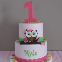 Owl 1St Birthday Cake This is a birthday cake I made for my daughter's 1st birthday. It is a vanilla and chocolate cake with oreo buttercream covered in mmf...