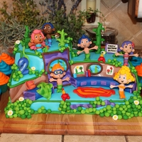 Bubble Guppies Cake!! Created this Bubble Guppies cake (which is 100% edibe aside from a thin lollipop sized dowel rod supporting each Bubble Guppies head) for...