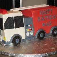 Firetruck Cake Done mainly in buttercream with fondant accents since my little guy doesn't like fondant that much.