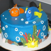 "Nemo Cake Nemo and Dory are made from fondant/gumpaste mix. Cake covered in buttercream with buttercream decorations and chocolate ""rocks&quot..."