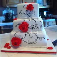 Black And Red Handpainted vines on fondant covered cake with red gumpaste roses.