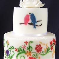 Love Birds In The Nature 2-tier dummy cakes covered with fondant, top stenciled with petal dust then lustre dust. Bottom tier dusted with petal dust only. Both...