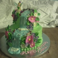 Tinkerbell Cake Vanilla cake with BC icing and fondant flowers. Rocks are candy too! Thanks to all CC members for your inspiration!