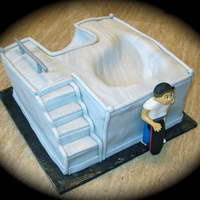 Skatepark Cake Carved the cake to look like a skatepark and then covered in fondant. The little boy is gumpaste TFL
