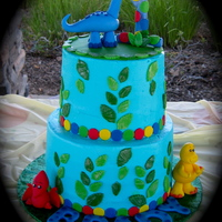 Dino Cake Buttercream with fondant and gumpaste decorations