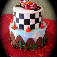 Disney Cars Theme Cake Made this cake for my 3 year old that loves Cars. Cake is buttercream with fondant decorations. McQueen is made of gumpaste.