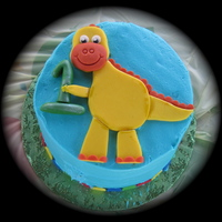 Dino Smash Cake Buttercream with fondant dino
