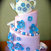 Teapot Cake Made this cake for my mom for her birthday. Cake is covered in buttercream. teapot and tea cups and other decorations are gumpaste TFL