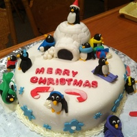 Penguin Winter Wonderland I borrowed and combined several penguin ideas and modified it a bit. One of my favorite cakes that I've done. MMF and the cake was...