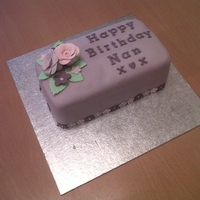 Rectangle Birthday Cake This is a fruit cake decorated with lilac fondant icing. I used flowerpaste to make the roses and flowers to add to the cake.