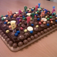 Chocolate Birthday Cake Chocolate traybake with chocolate icing with different sweets including malteasers, galaxy counters, m&m's, magic stars and milky...